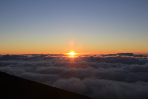 sunset over the clouds from the Haleakala summit